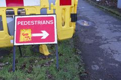 Footpath closed sign for pedestrian safety from road construction on busy street. Uk royalty free stock photo