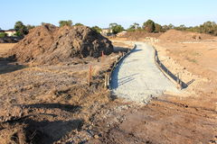 Footpath construction. Construction of new footpath with edging ready for concreting in new suburban realestate subdivision royalty free stock photos