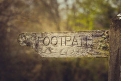 Footpath direction vintage sign. In park close up Stock Photos