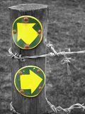 Footpath Directions. Arrows on a fence post indicating a split in the direction of a footpath Royalty Free Stock Photography