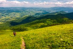 Footpath down the hillside in to the valley. Beautiful mountainous landscape in summertime. summer outdoors activity concept. location mountain Pikui Stock Photos