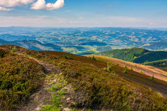 Footpath on the edge of alpine hillside. Beautiful view of valley in Carpathian mountainous region Stock Photography