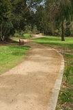 Footpath in empty park Royalty Free Stock Photography