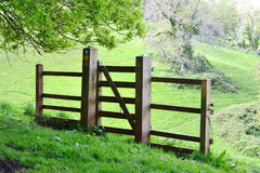 Footpath Gate with Partial Fence. When hiking the many footpaths in the UK, one will find gates and fences of all sorts to navigate. This one has a gate and a Stock Photography