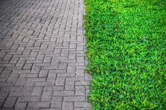 A FOOTPATH AND GRASS WITH SPLIT TONE stock photography