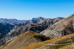 Footpath at High Altitude. Beautiful landscape at high altitude in the Southern Franch Alps with a small footpath in the bottom of the image Royalty Free Stock Image