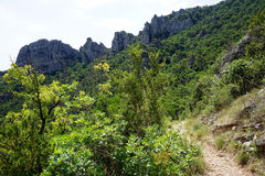 Footpath. Hiking trail in Gellone valley near Saint-Guilhem-le-Desert, France stock photography