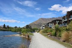 Footpath by Hilton Queenstown and Kawarau River NZ. View along the footpath in front of the Double Tree by hilton Hotel Queenstown, Otago, South Island, New Royalty Free Stock Photos