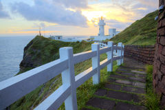 Footpath leading to a lighthouse on the cliff in northern coast of Taiwan Stock Photos