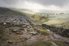 Footpath from limestone pavement down to Malham Cove in Yorkshir. E Dales National Park during Autumn sunrise Stock Photography