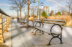 Footpath Lined with Wooden Benches Stock Photography