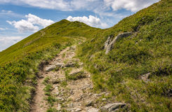 Footpath through the mountain ridge Stock Photo