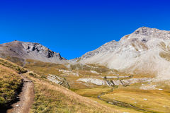 Footpath in the Mountains. Hiking footpath in The South Alps (Alpes du Haute Provence),in France, leading to the Small Cayolle Mountain Pass (Col de la Petit Stock Images
