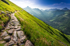 Footpath in the mountains at sunrise Stock Image