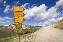 Footpath and mtb direction sign in Italian Alps, Livigno. Footpath and mountain bike direction sign in Italian Alps Livigno Royalty Free Stock Images