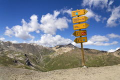 Footpath and mtb direction sign in Italian Alps, Livigno. Footpath and mountain bike direction sign in Italian Alps Livigno Stock Photo