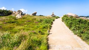 Footpath in natural park of Ploumanac'h site. Travel to France - footpath in natural park of Ploumanac'h site of Perros-Guirec commune on Pink Granite Coast of Royalty Free Stock Image