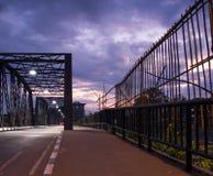 Footpath near iron bridge in early morning Royalty Free Stock Image
