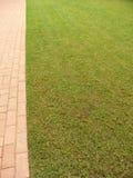 Footpath next to grass Stock Photo