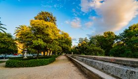 A footpath over the park of Turia during sunset. Valencia royalty free stock photo