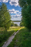 The footpath. Path going off into the distance to the cool river water. On a Sunny summer day royalty free stock images