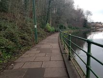Footpath on river stock photos