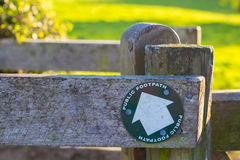 Footpath sign. Attached to fence Royalty Free Stock Images