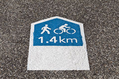 Footpath Sign. Pedestrian and cyclists footpath sign indicating the distance in Km to the nearby park Stock Photos