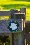Footpath sign. Public footpath sign on gate, pointing to the left Stock Image