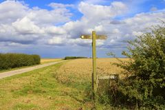 Footpath sign. A wooden footpath sign on the minster way bridleway in the yorkshire wolds under a blue summer sky Stock Photos