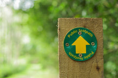Footpath sign on wooden post Royalty Free Stock Photo