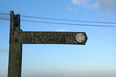 Footpath sign. A wooden public footpath sign pointing the way to go Stock Images