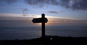 Footpath signpost at sunset. Footpath signpost silhouette against an Isle of Anglesey sunset royalty free stock images