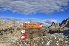 Footpath signs in dolomites mountain Stock Photos