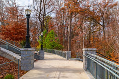 Footpath and stairs to Grand Arbor in Piedmont Park, Atlanta, USA. Concrete footpath and stairs to Grand Arbor in the Piedmont Park in sunny autumn day, Atlanta Stock Photo