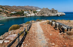 Footpath to blue lagoon of Aghios Pavlos town on Crete island, Greece.  Royalty Free Stock Photography