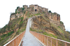 Footpath to Civita di Bagnoregio, Italy. Civita di Bagnoregio is noted for its striking position atop a plateau of friable volcanic tuff overlooking the Tiber Royalty Free Stock Photos