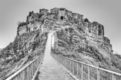 Footpath to Civita di Bagnoregio, Italy. Civita di Bagnoregio is noted for its striking position atop a plateau of friable volcanic tuff overlooking the Tiber Royalty Free Stock Photo