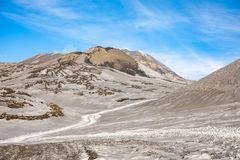 Footpath to Etna Volcano with smoke in winter, volcano landscape, Sicily island, Italy stock photography