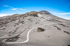 Footpath to Etna Volcano with smoke in winter, volcano landscape, Sicily island, Italy stock photos