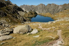 Footpath to glacial lake in Pyrenees Royalty Free Stock Photo