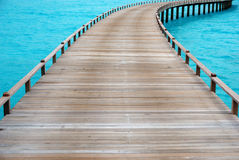 Footpath to the sea. Old wooden jetty leading out into the Indian Ocean Royalty Free Stock Images
