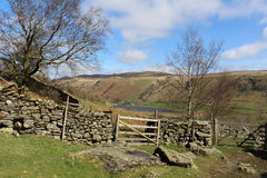 Footpath to Watendlath, gates and dry stone wall Royalty Free Stock Image