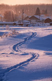 Footpath traces in the snow in russian  Altai village in Winter Stock Image