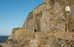 Path under cliffs at Ilfracombe, Devon, England Stock Photo