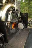 Footplate and open firebox on narrow gauge steam locomotive Stock Images