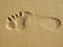 Footprint. A single big male footprint in the sand Royalty Free Stock Photo