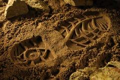 Footprint of an adventure boot. Footprint on a sandy surface Stock Image