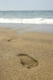 Footprint Beach. Footprint of someone leaving the water Royalty Free Stock Photography