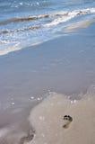 Footprint on beach. Footprint on the sandy beach and sea wave Stock Photos